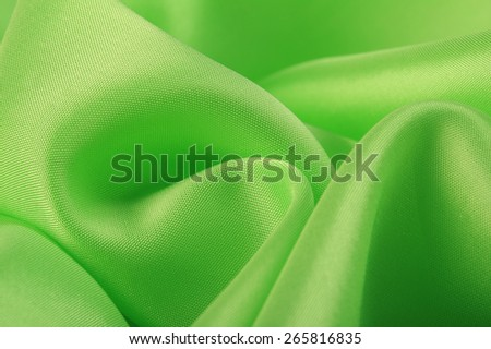 macro texture smooth satin fabric light green color studio - stock photo