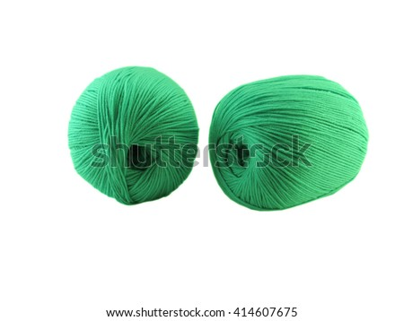 macro two green woolen balls of threads for knitting on a white background