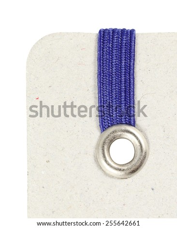 Macro view of a tin eyelet with blue elastic band on a notepad.  - stock photo