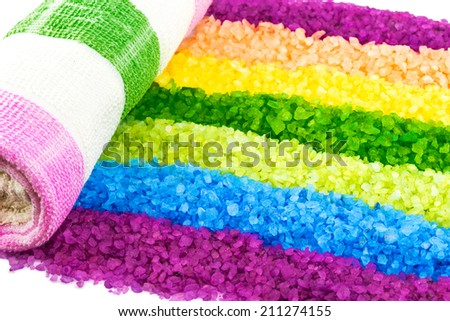 Macro view of bright rainbow of sea salt and towel - stock photo