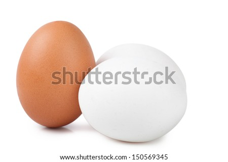 Macro view of brown and white eggs on the white background - stock photo