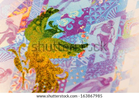 Macro view of fire bird on the one hundred rubles olympic banknote - stock photo