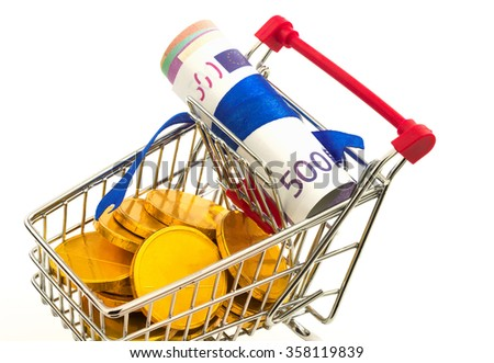 Macro view of money and coins in the metal trolley - stock photo