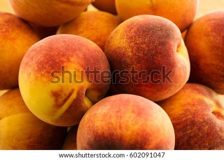 macro view ripe peaches heaping pile stock photo royalty free
