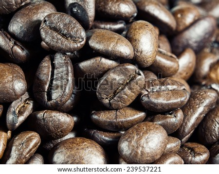Macro view of roasted whole coffee beans.