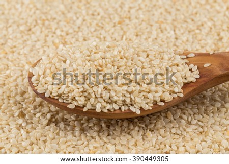 Macro view of sesame seeds on spoon  - stock photo