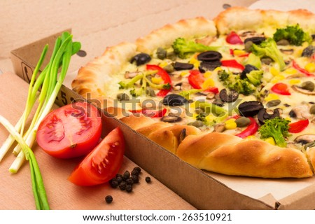 Macro view of tasty pizza with ingredients - stock photo