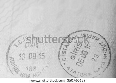 Macro view of Turkey entry and exit stamps on european passport. - stock photo
