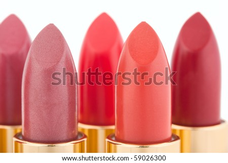 Macro view of two red lipstick heads isolated on white, shallow depth of field - stock photo