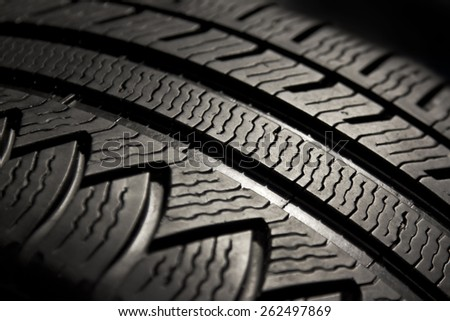 Macro view on pattern of a car tire. - stock photo
