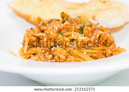 Macro with spaghetti bolognese - stock photo