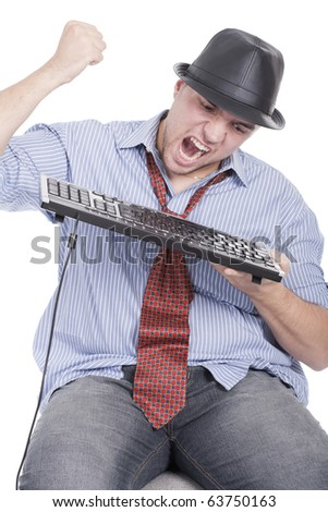 mad and angry man destroying the the keyboard - stock photo