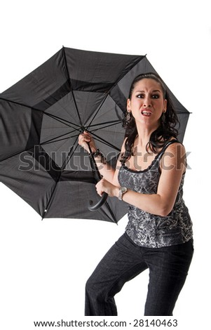 Mad and crazy beautiful caucasian woman with umbrella, isolated - stock photo