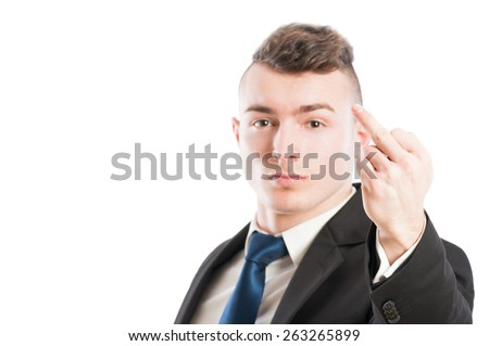 Mad business man showing the middle finger on white background with copy space