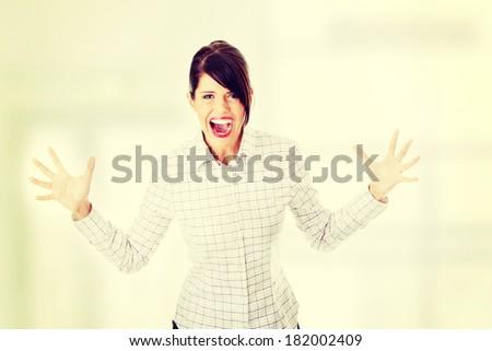 Mad business woman portrait - stock photo