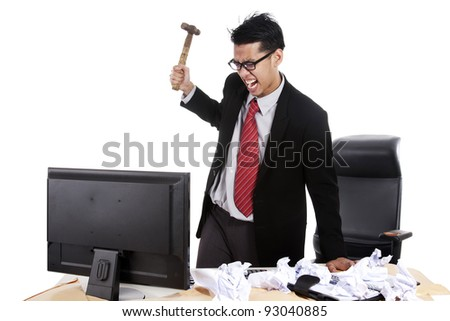 Mad businessman preparing to hitting his computer - stock photo