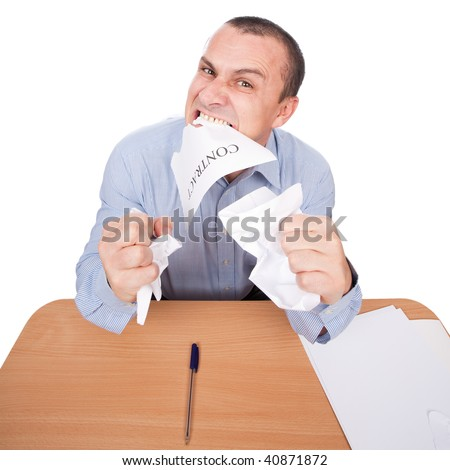 Mad businessman tearing apart a contract with his teeth, isolated on white background - stock photo