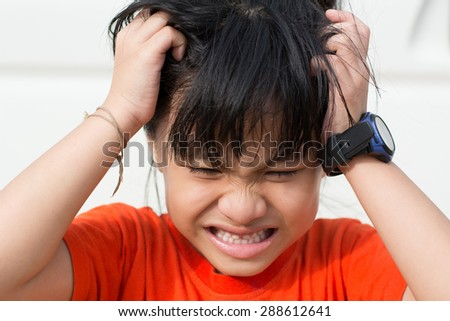 Mad Child , because lice on the head. - stock photo