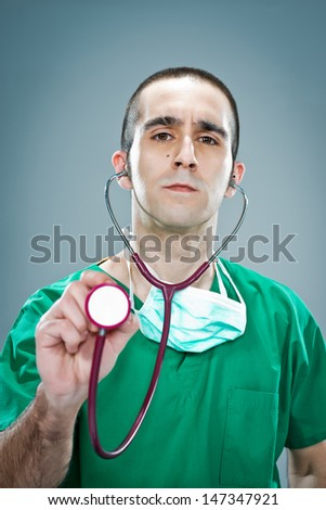 Mad Doctor with a Stethoscope Over a White Background - stock photo