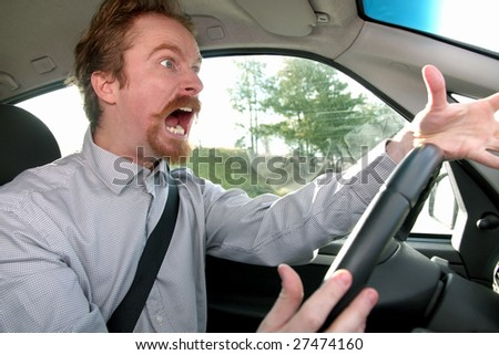 mad driver in a car - stock photo