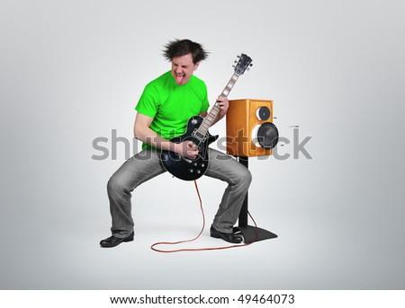 Mad guitarist - stock photo