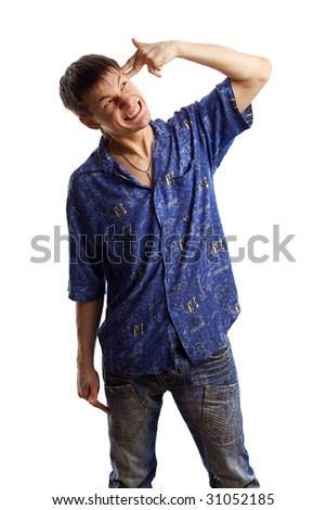 Mad guy in the blue shirt trying to kill himself with his finger over white background - stock photo