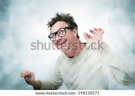 Mad Professor in smoke, art concept of science - stock photo