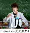 Mad professor laughs handing test tube in his laboratory - stock photo