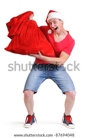Mad Santa Claus with a bag of gifts on white background - stock photo