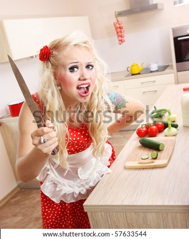 Mad woman in the kitchen - stock photo
