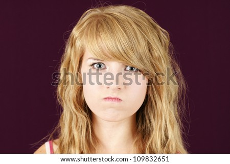Mad young blond teenage girl, funny face concept. - stock photo
