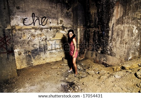 Mad young woman in a dirty place - stock photo