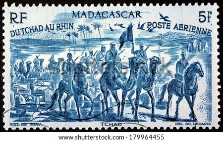 MADAGASCAR - CIRCA 1946: A postage stamp printed by MADAGASCAR shows Free French Forces in Chad,  West Africa (1940), circa 1946 - stock photo