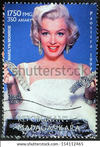 MADAGASCAR - CIRCA 1999: A postage stamp printed by MADAGASCAR shows image portrait of famous American actress, model and singer Marilyn Monroe (1926-1962), circa 1999 - stock photo