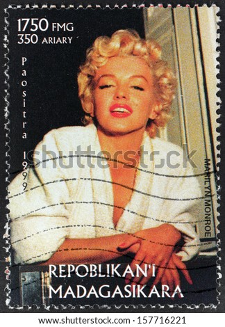 MADAGASCAR - CIRCA 1999: A postage stamp printed by MADAGASCAR shows image portrait of famous American actress, model and singer Marilyn Monroe (1926-1962), circa 1999. - stock photo