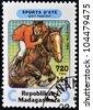 MADAGASCAR - CIRCA 1994: A stamp printed in Madagascar dedicated to summer sports shows  Equestrianism, circa 1994 - stock photo