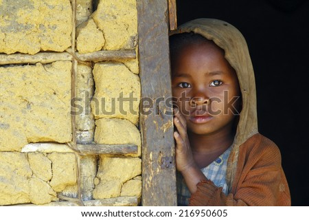 Madagascar-shy and poor african girl with headkerchief - stock photo