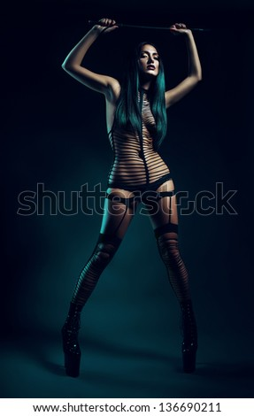 madam in high shoes with whip - stock photo