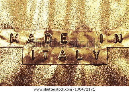 Made In Italy logo on a golden background