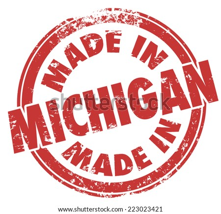 Made in Michigan words in a round red ink stamp as a badge, logo or emblem showing pride in manufacturing or production in the state - stock photo