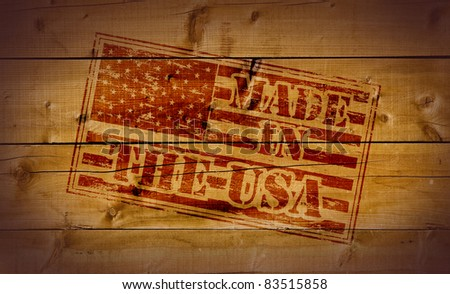 Made in the USA rubber stamp on wooden background - stock photo