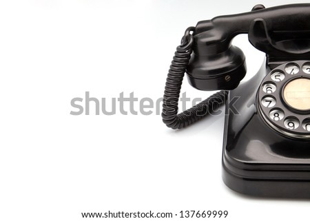 made obsolete bakelite phone on white fund - stock photo