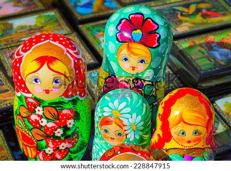 Made of a tree and beautifully painted dolls - the nested dolls, traditional Russian toys for children. - stock photo