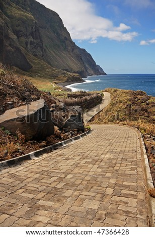 Madeiran coastal footpath which is only accessible by boat or cable car - stock photo
