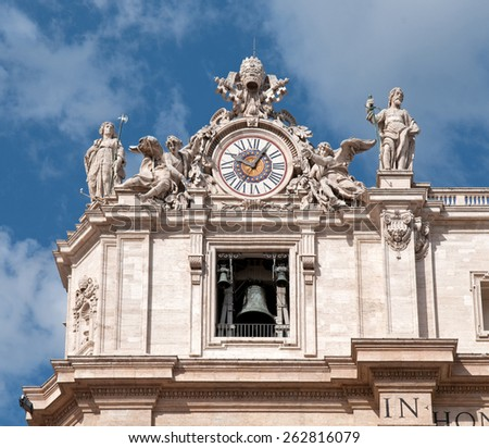 Maderno's facade with the sculptures and clock against the sky background. St. Peter's Basilica -  Vatican City. - stock photo
