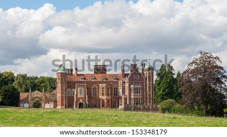 Madingley Hall, built in 1543 by Sir John Hynde, currently part of Cambridge University - stock photo