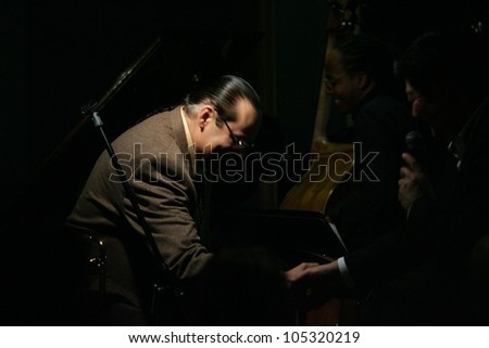 MADISON, NJ - JUNE 16: Steve Turre (L) bows as he shakes hands with restaurant owner David Niu (in shadow) after performing with his Quartet at Shanghai Jazz on June 16, 2012 in Madison, NJ.