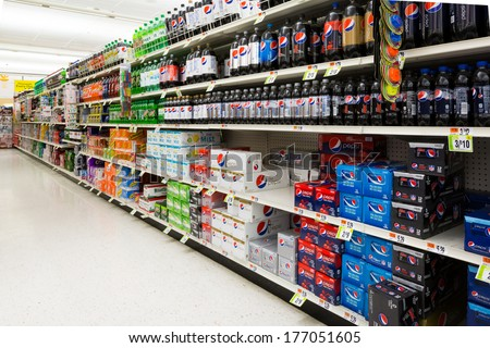 MADISON, NJ, UNITED STATES - FEBRUARY 13, 2014: Soft drinks aisle in an American supermarket. The affordability and wide variety of sugary drinks contribute to the growing obesity problem in the U.S. - stock photo