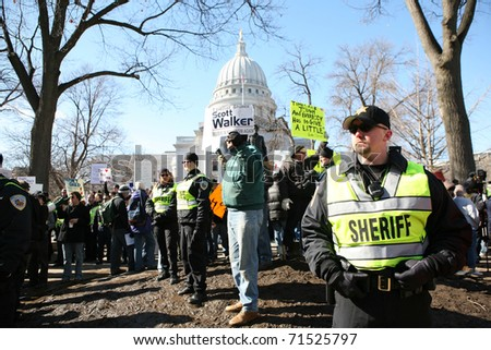 MADISON, WI-FEB 19:Deputies with the Dane County Sheriff Dept stood guard at a rally organized by the Tea Party on February 19, 2011 in Madison, Wisconsin. - stock photo