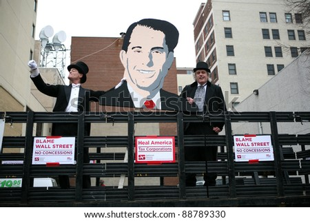MADISON,WI - FEB 19: Opponents hold a image of Gov Scott Walker, at a march protesting his attack on public workers on Feb 19, 2011 in Madison, WI.  The Wisconsin drive to recall Walker starts Nov 15. - stock photo
